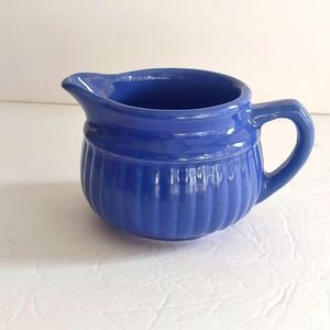 VNTG. Cobalt blue creamer with USA stamp.